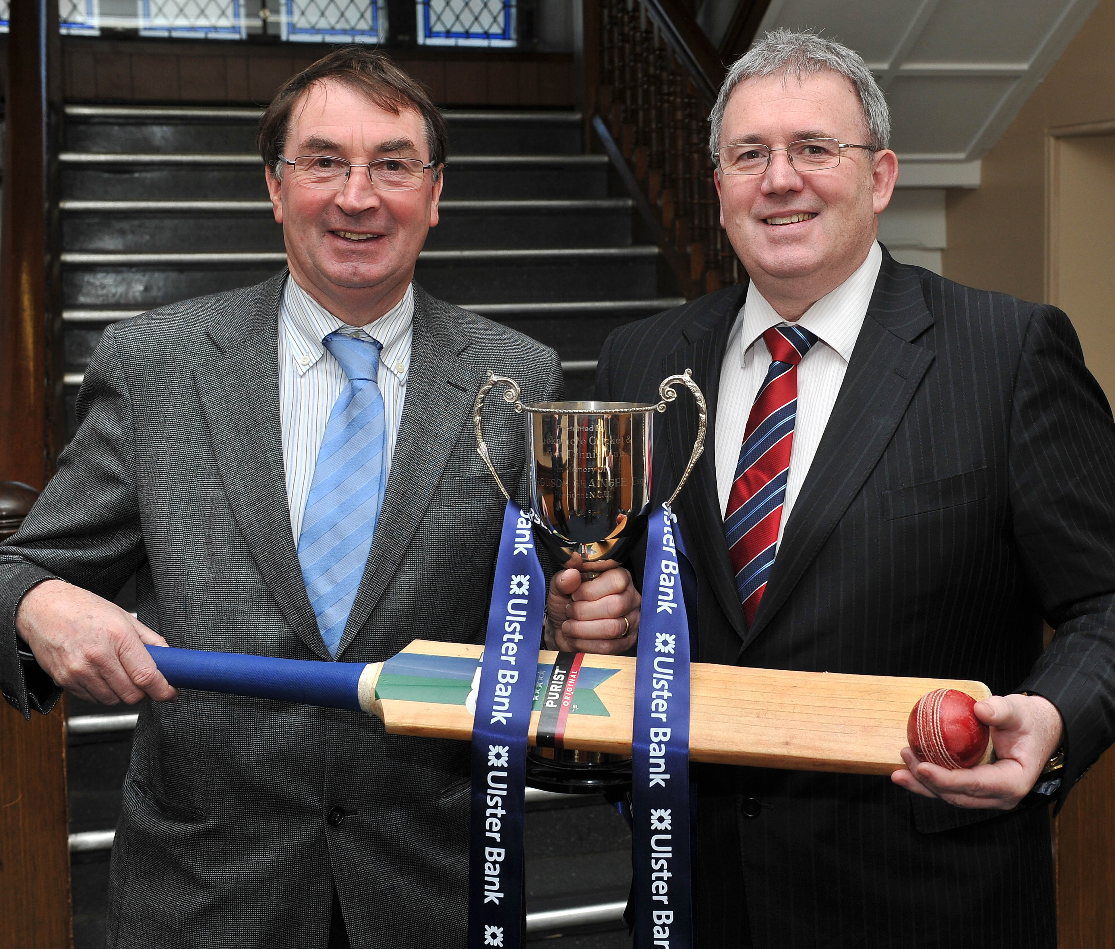 NCU President Chris Harte and Stephen Cruise from the Ulster Bank make the draw for this year's Schools Cup