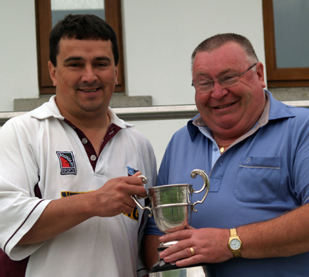 Robin Glenn presents Leslie Allen with the Intermediate League Three trophy